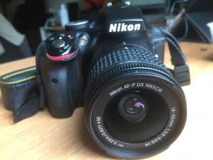 Nikon D3300 SLR camera body and lens