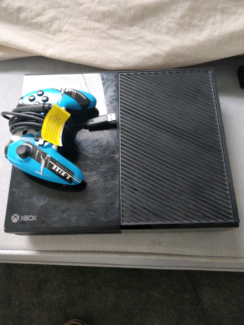 Xbox one with a controller and games